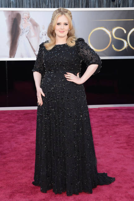 Oscar winner (and new mom!) Adele kept her look simple and classic in a sparkly black number by Jenna Packham and Harry Winston diamonds.
