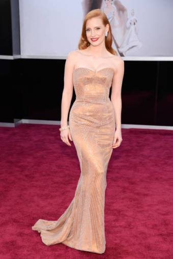 Jessica Chastain's old-Hollywood waves and red lip were perfectly paired with her custom copper Armani Prive gown and Christian Louboutins.